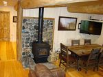 view of cabin interior wood stove and hallway